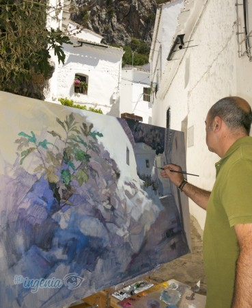 El pintor ubriqueño Juan Pedro Viruez, durante la ejecución de su cuadro, que obtuvo el noveno premio.