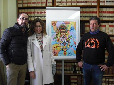 Miembros del jurado, con la obra ganadora.