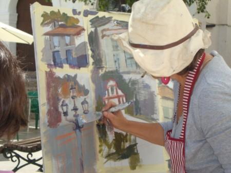 Participante en el concurso de pintura rápida al aire libre, en La Plaza (Reportaje fotográfico: Merceditas Sígler).
