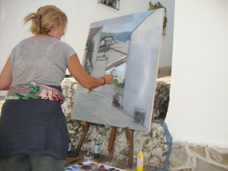 Participante en el concurso de pintura rápida al aire libre, en la calle Caracolillo.